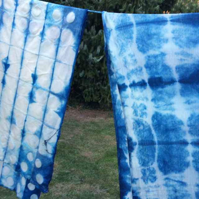 Shibori - the fabric on the left was clamped with wooden circular pieces and the piece on the right was folded and tied with string.