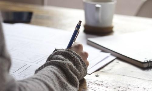girl writing feedback