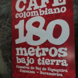 sign of a Colombian cafe 180 meters below the ground