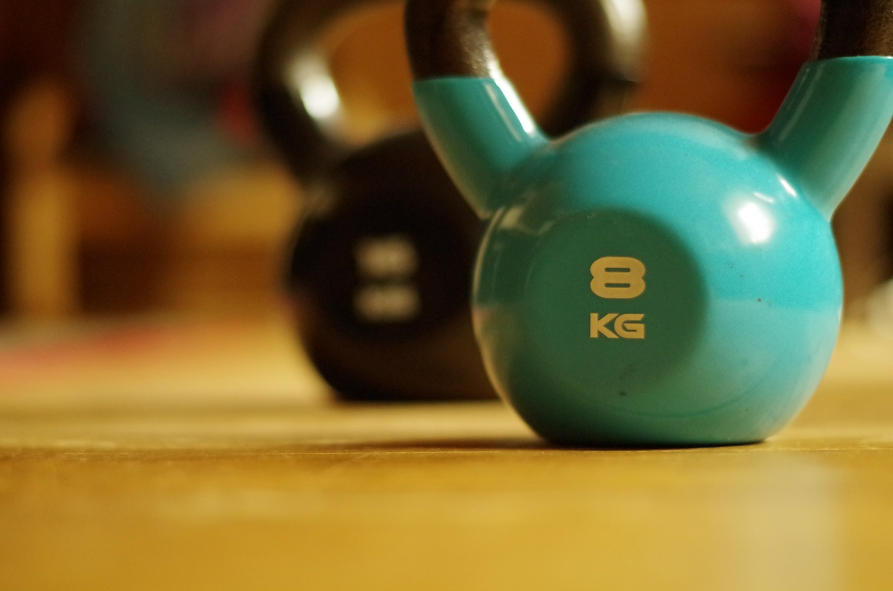 blue and black kettlebell 8 kilograms on wooden floor