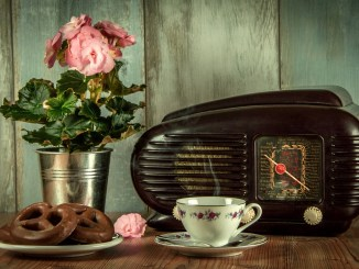 Vintage radio with coffee and chocolate pretzels flower pot good news