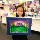 Girl holding painting