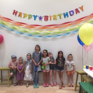 Posing in front of birthday banner