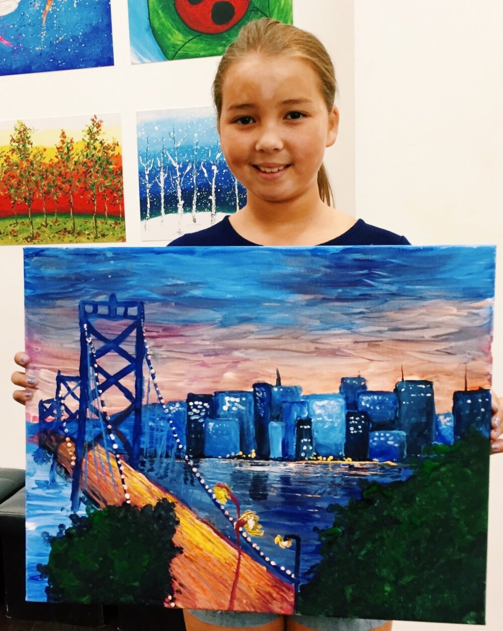 young artist with the bay bridge and city in background