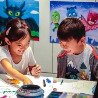 students smiling looking at art
