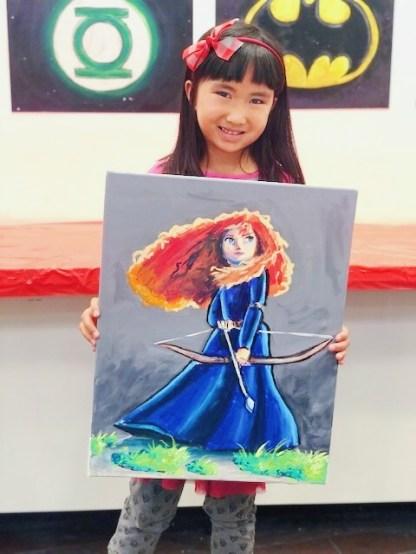 student with Merida art work