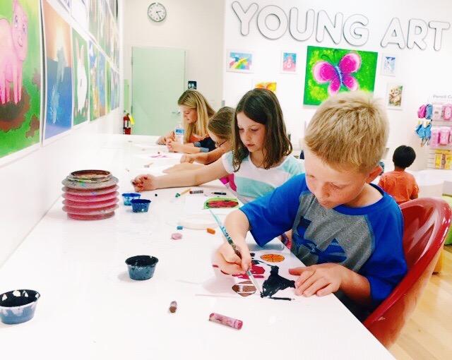 image of students making art in studio