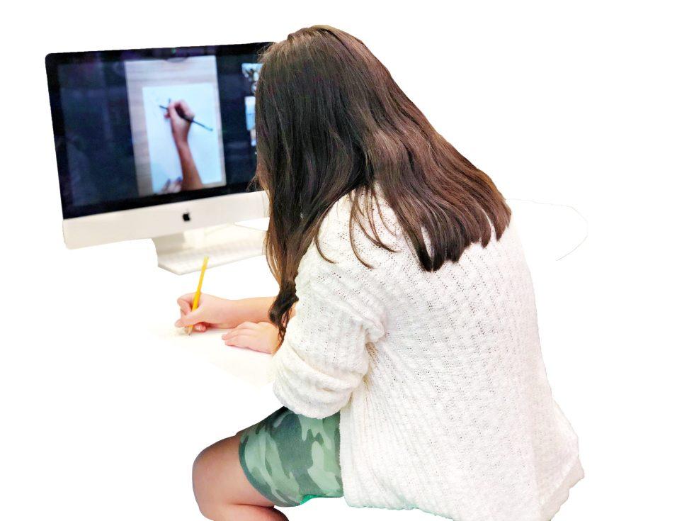 student taking virtual lesson