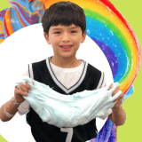 student holding lots of slime