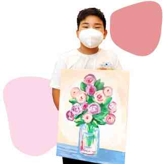 Image of a boy showing his flowers in a vase paint