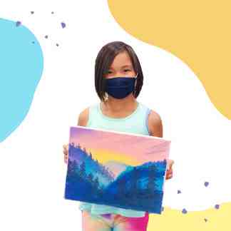 Image of a student holding her scenery painting