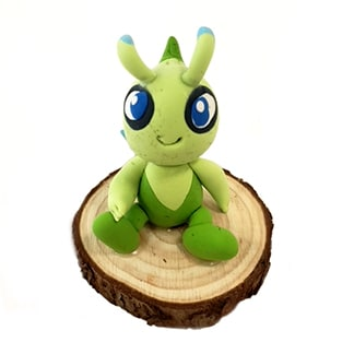 clay sculpture of a green character