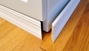 Best Way To Cut Laminate Flooring person cutting the board lengthwise using a circular saw Adding Molding To Cabinets To Make Them Look Built In