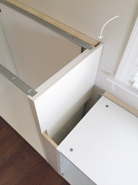 white cabinet filler pieces used to cover exposed side of Ikea cabinet installation