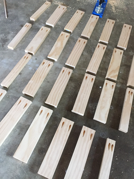 Floating shelf supports made from 1x3 pine boards cut to the same length and drilled with pocket holes using a Kreg Jig