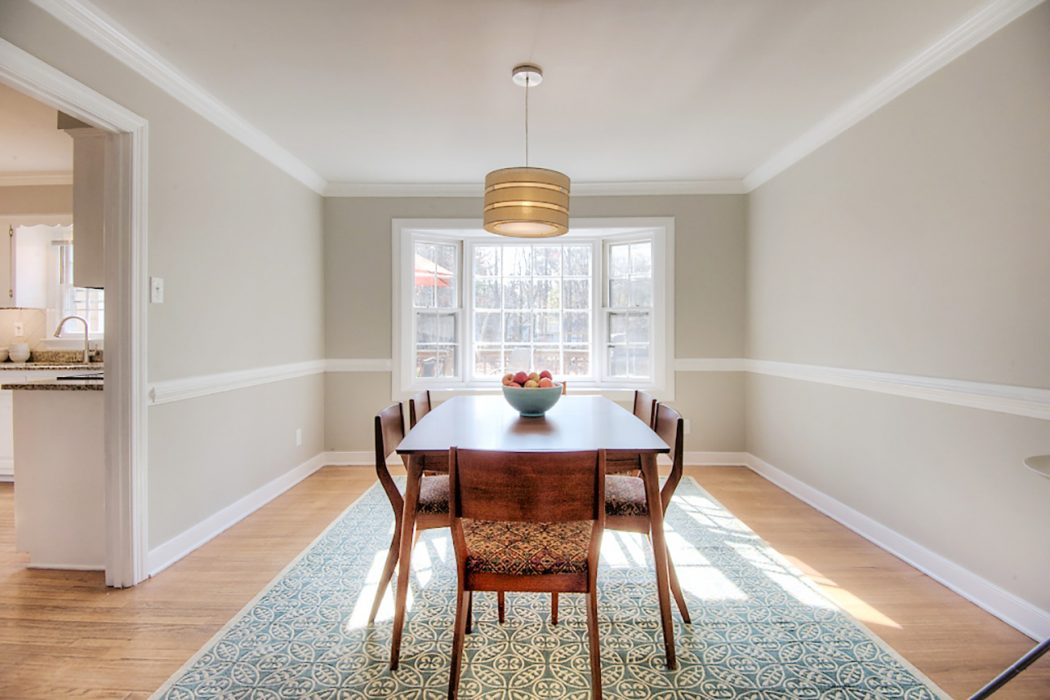 living room staged to sell with neutral walls and simple table