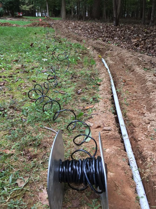 underground wire run alongside pipe for irrigation system install