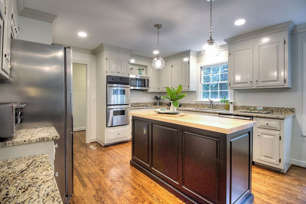 kitchen staged to sell by removing items on counters and refrigerator
