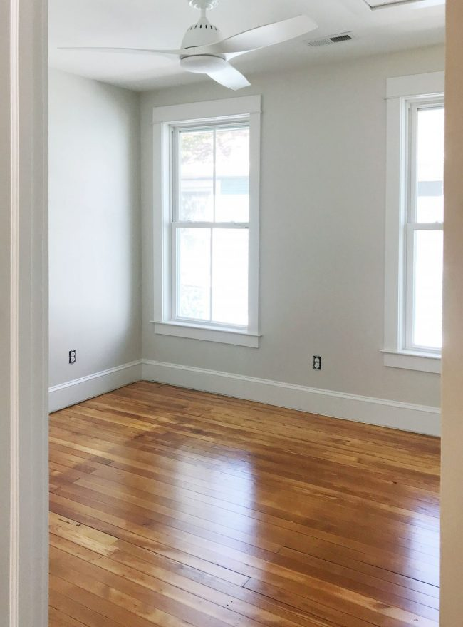 refinished pine floors upstairs bedroom white fan