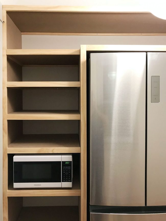 left side of built in pantry shelving with all face pieces installed