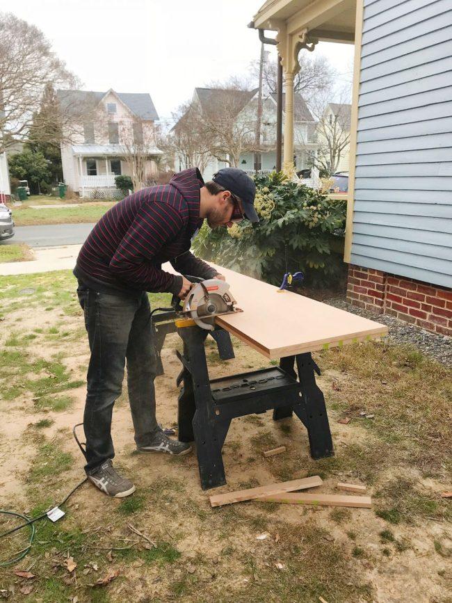 John cutting MDF panels outside