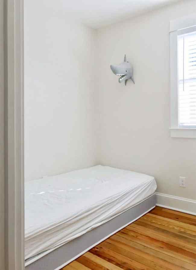 before shot of mattress on floor in bunk room