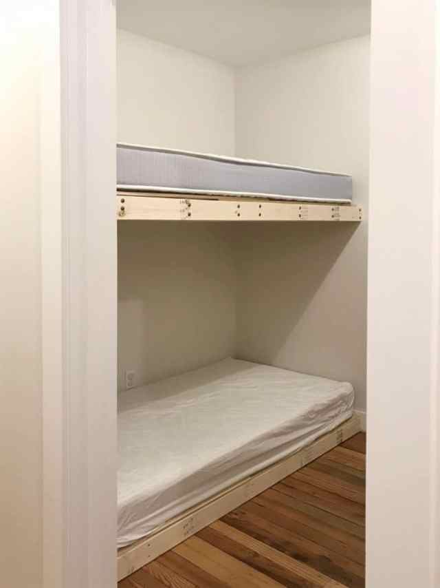 two diy bunk bed platforms built and in place
