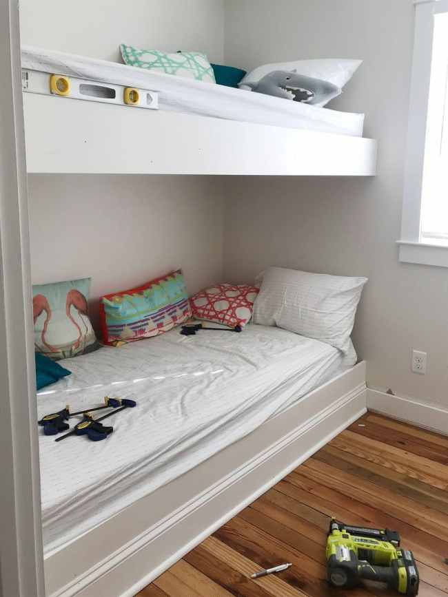 white trim pieces added to the face of bunk bed platforms