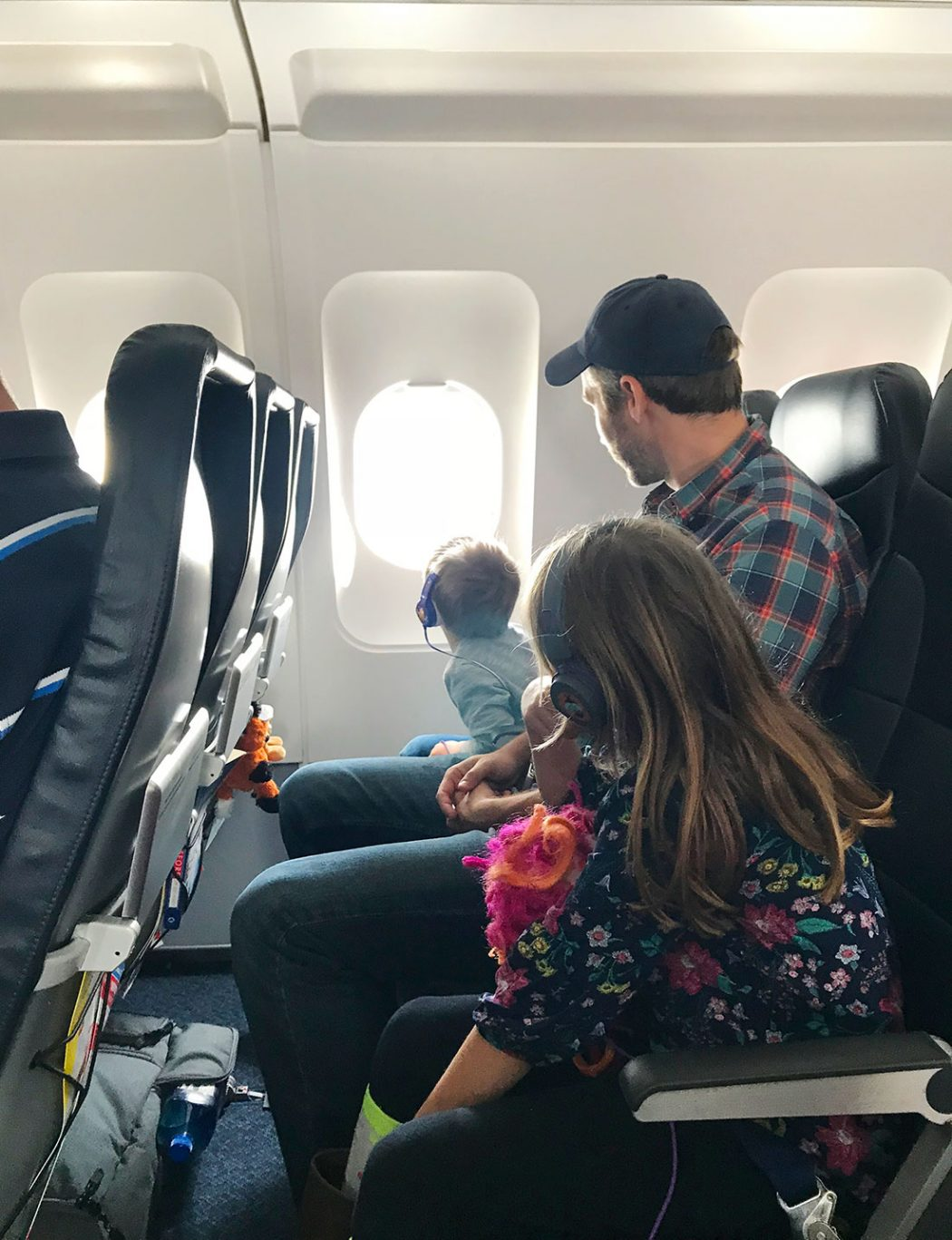John and kids on plane to spring break in florida
