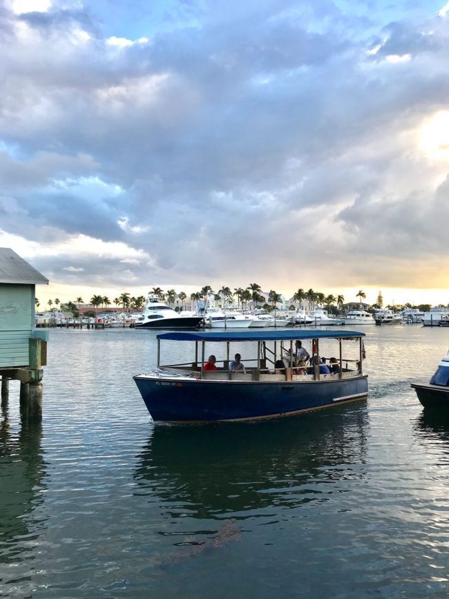 small boat picking up diners for Cap's Place Restaurant in Lighthouse Point Florida