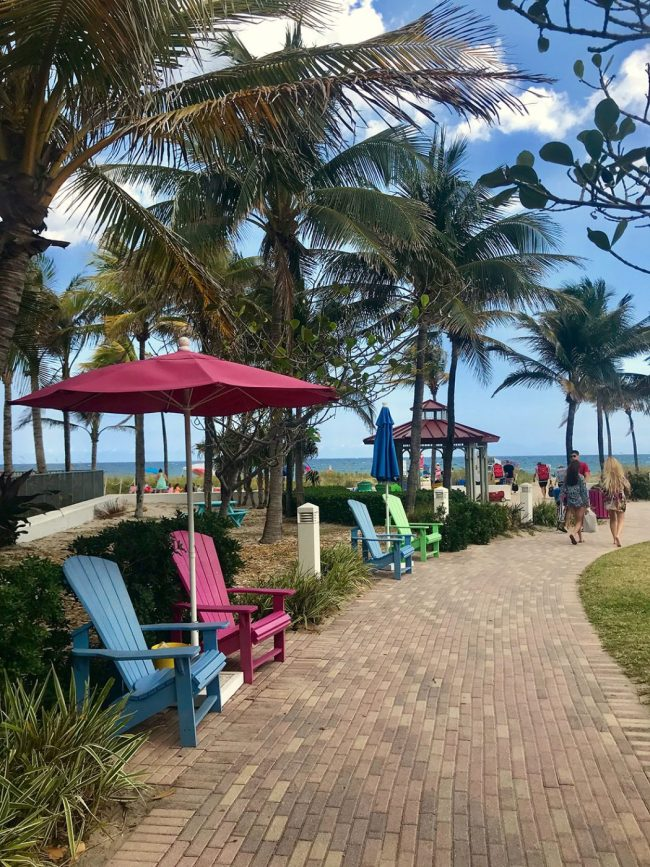 colorful beach chairs and umbrellas at Lauderdale By The Sea Florida