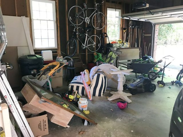Messy garage with bikes and spare furniture