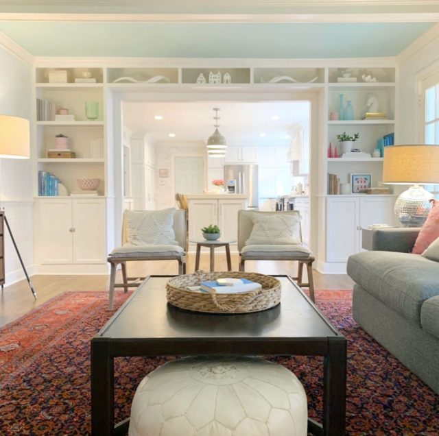 Living Room With Built In Bookcases and Wood Coffee Table