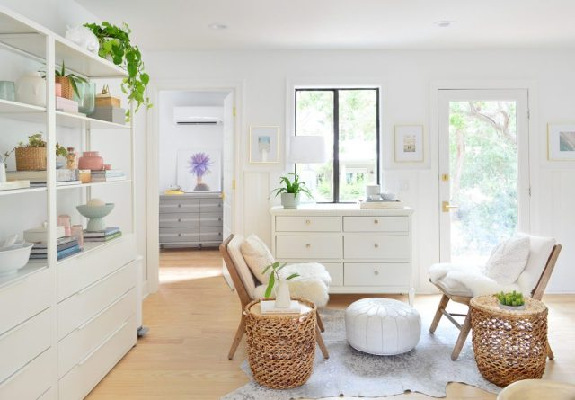Seating area in white kitchen with chairs and opens shelving
