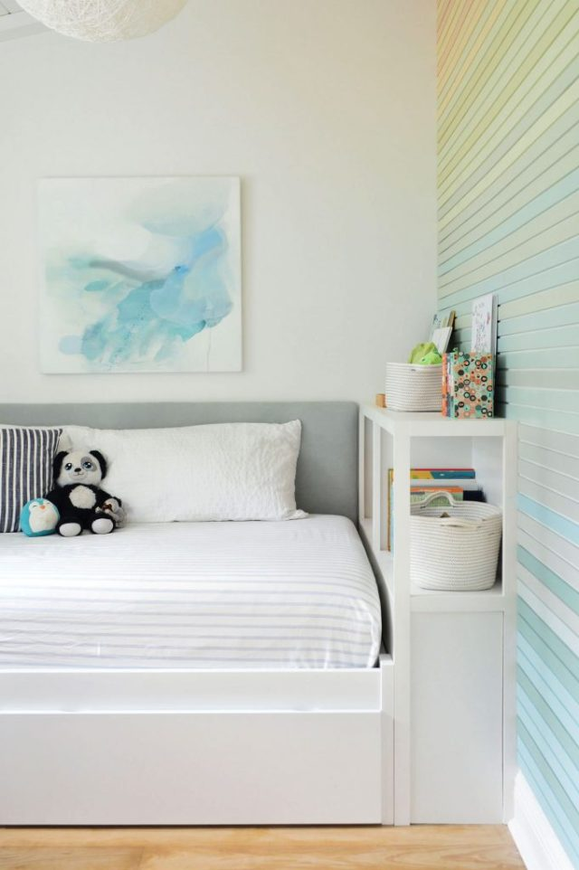 Boys Twin Bed With Fabric Headboard Bookcase And Rainbow Gradient Wall Treatment