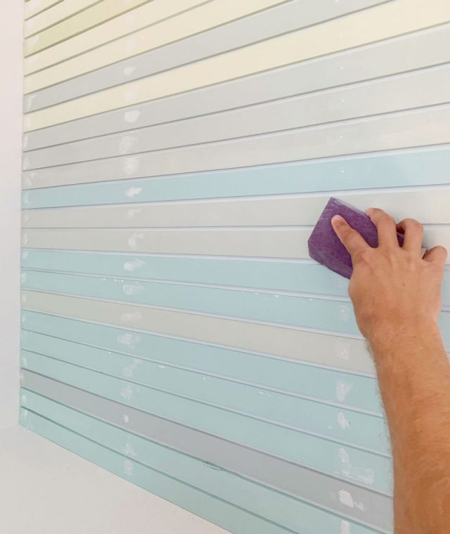 Hand Sanding Spackled Holes On Striped Wall Treatment