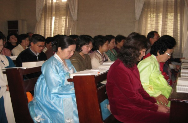 North Korean praying in Church