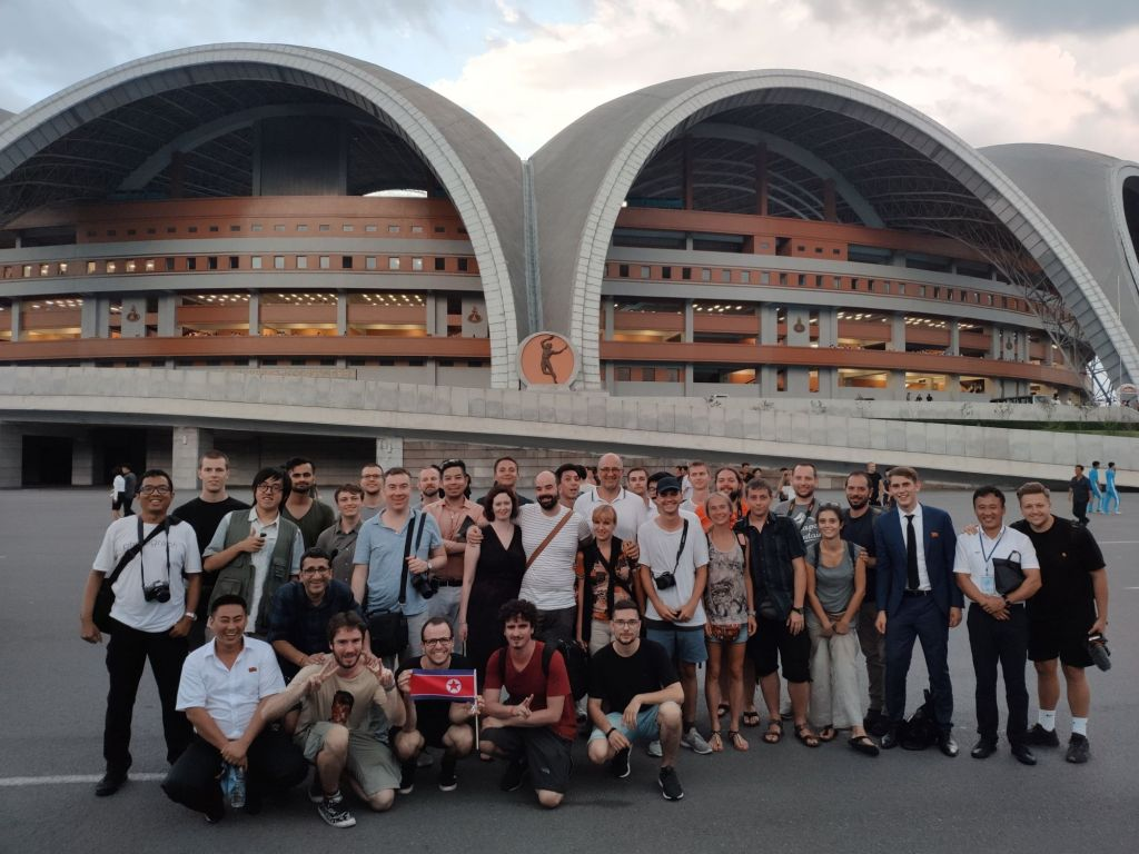 Our group standing in front of the Rungrado May Day Stadium