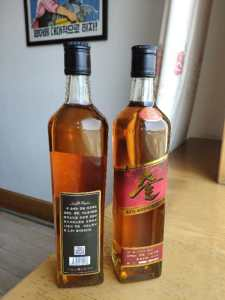 North Korean Whiskey | North Korea's new 'Samilpo' whiskey -- black label on the left and red label on the right.