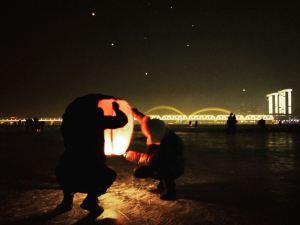 Lighting lanterns along the river