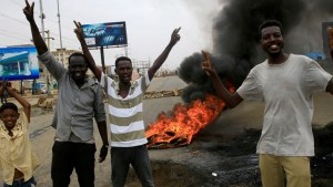 Sudan coup: young men protesting in Khartoum