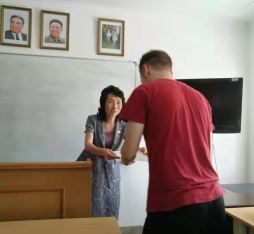A student receiving his certificate on his Pyongyang Korean Language Study Tour