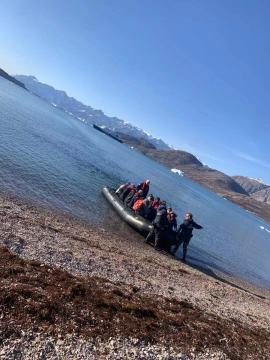 Our Zodiac boat boards a gravelly beach on Greenland.