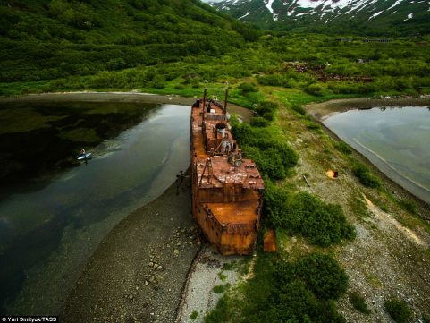 The rusting hulk of a ship sits grounded at Kamchatka.