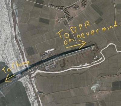 A satellite map showing the finished (but unused) New Yalu River Bridge on the North Korean side.