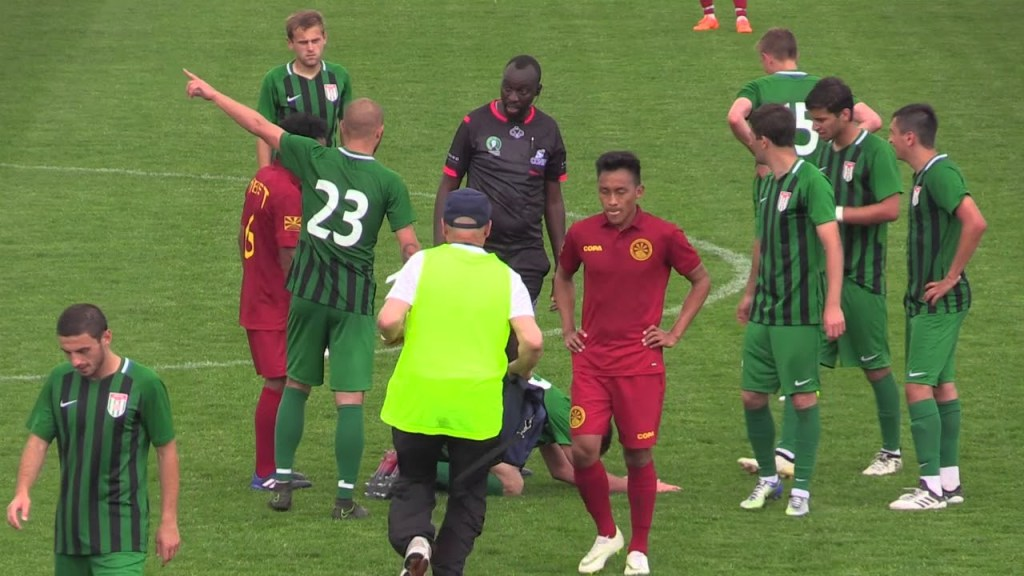 Abkhazian players dispute the referee's decision versus a CONIFA game against Tibet.
