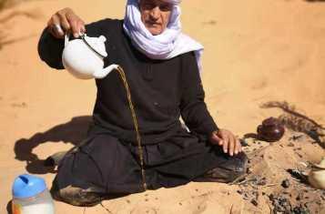 A nomad serves tea in the Algerian Desert near Taghit