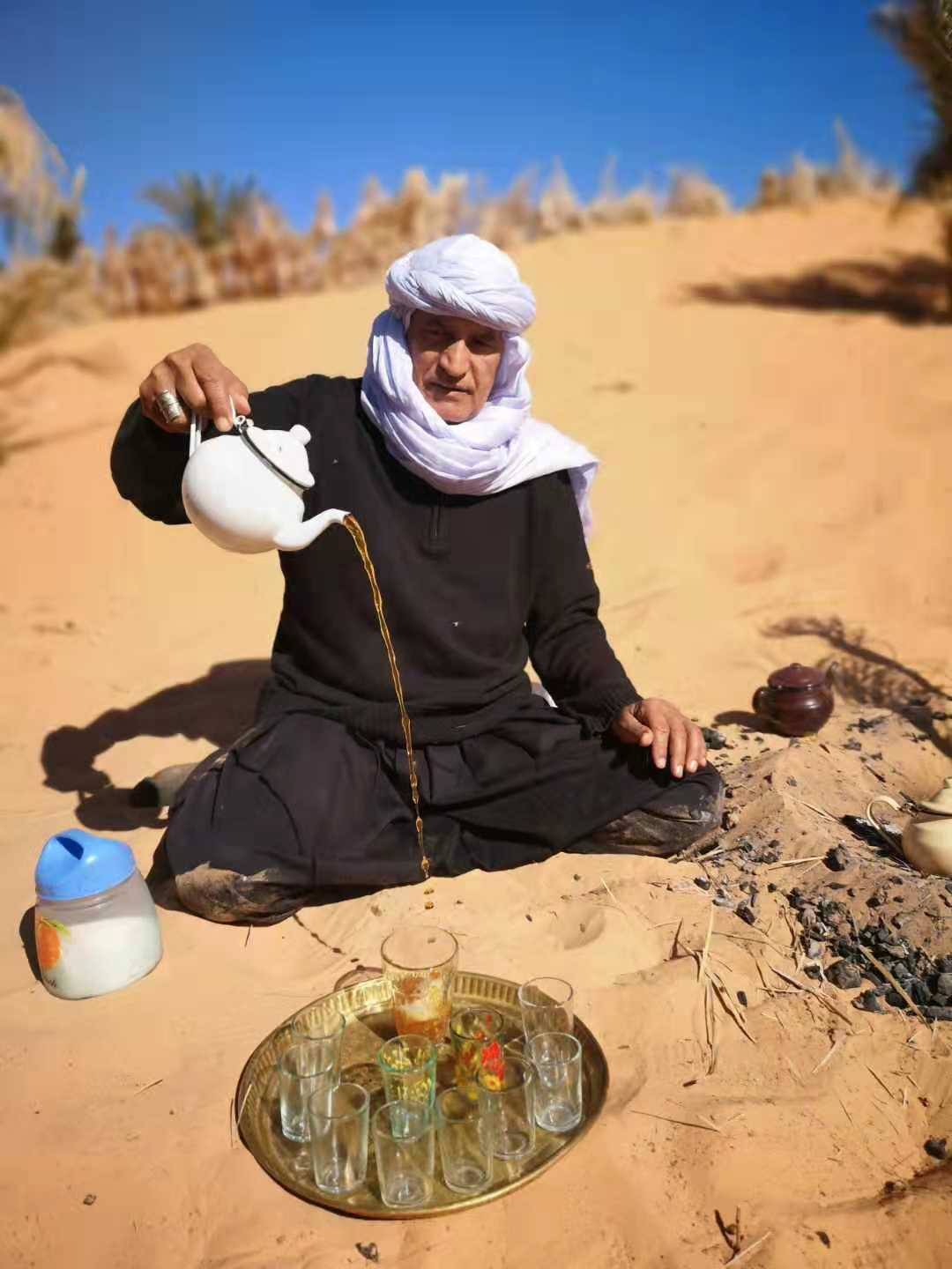 A nomad serves tea in the Algerian Desert near Taghit