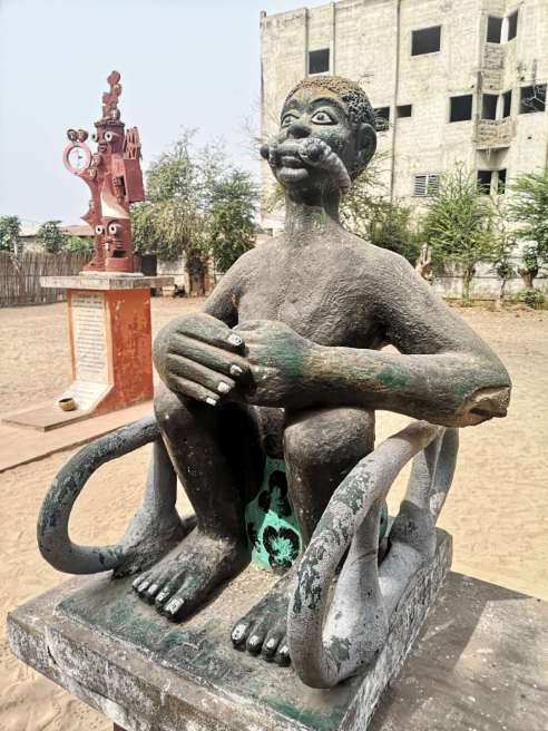 The statue of a gagged slave on the slave trail of Ouidah
