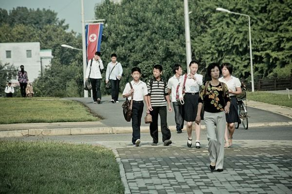 North Koreans of different heights walking in the streets